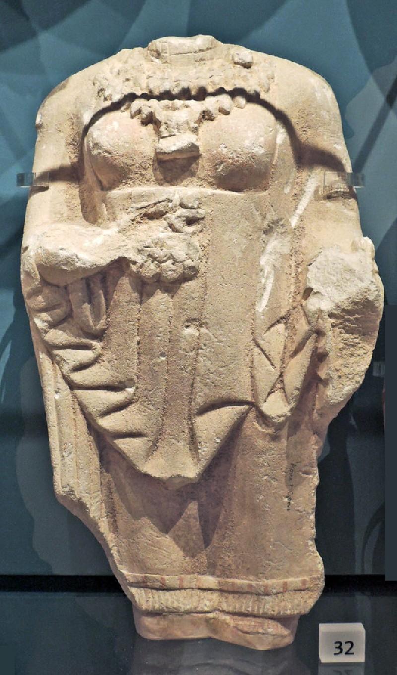 Limestone torso of female votary with Ionic mantle, Kore, votive statuette