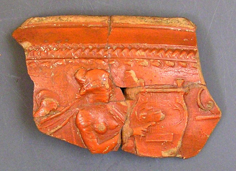 Fragment of Arretine ware bowl, female figure playing lyre stamped in Latin