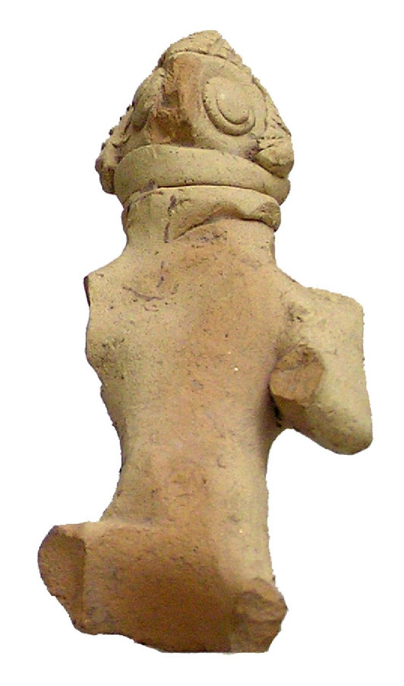 Figurine of a horseman wearing heavy helmet, and perhaps a shield on his back (AN1914.131, AN.1914.131, record shot)