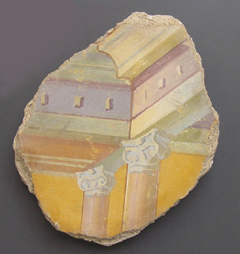Fragment of painted wall plaster with architectural decoration