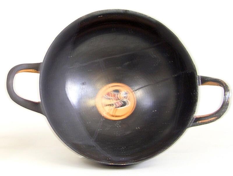 Attic black-figure pottery stemmed cup depicting a mythological figure