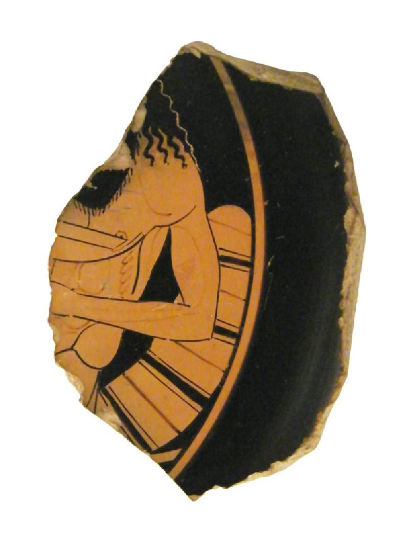 Attic red-figure pottery plate sherd depicting a Dionysiac scene