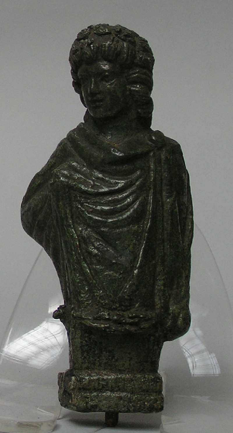 Bronze furniture fitting of a youth wrapped in a cloak