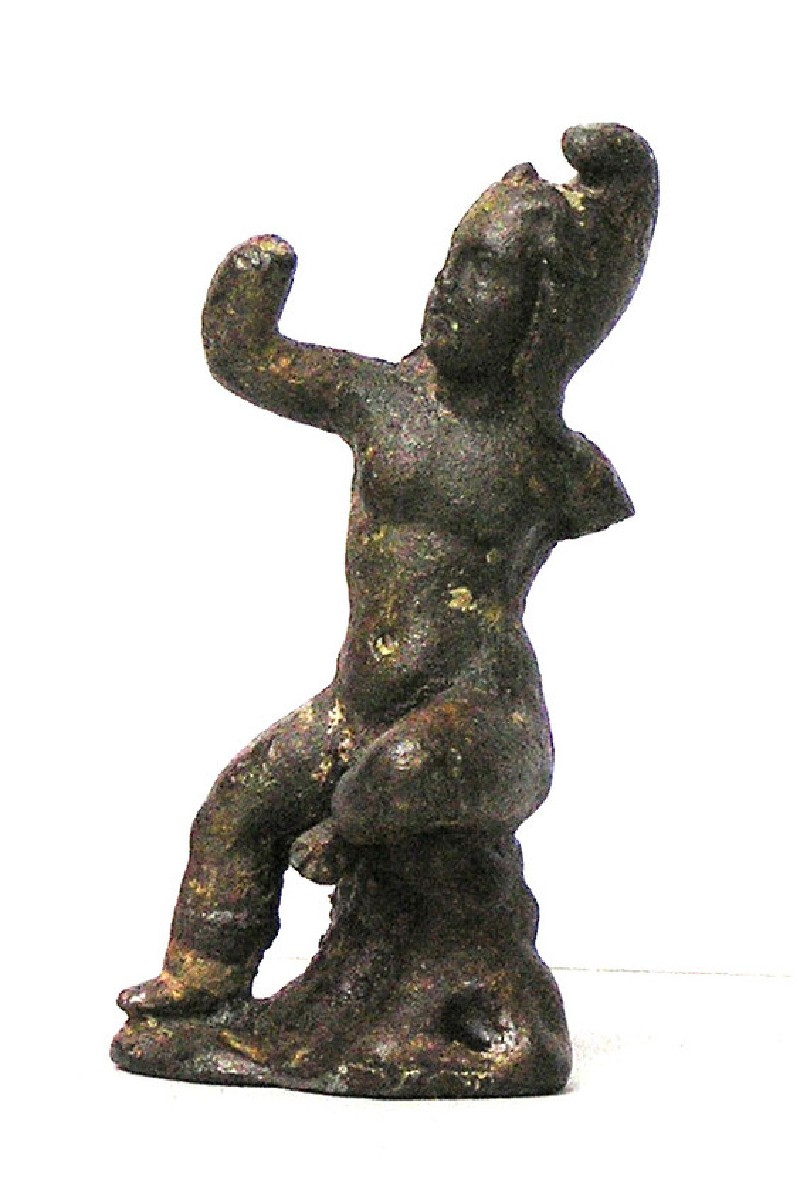 Bronze figure of seated child wearing Phrygian cap, perhaps Atys or Mithras (AN1950.213, AN.1950.213, record shot)