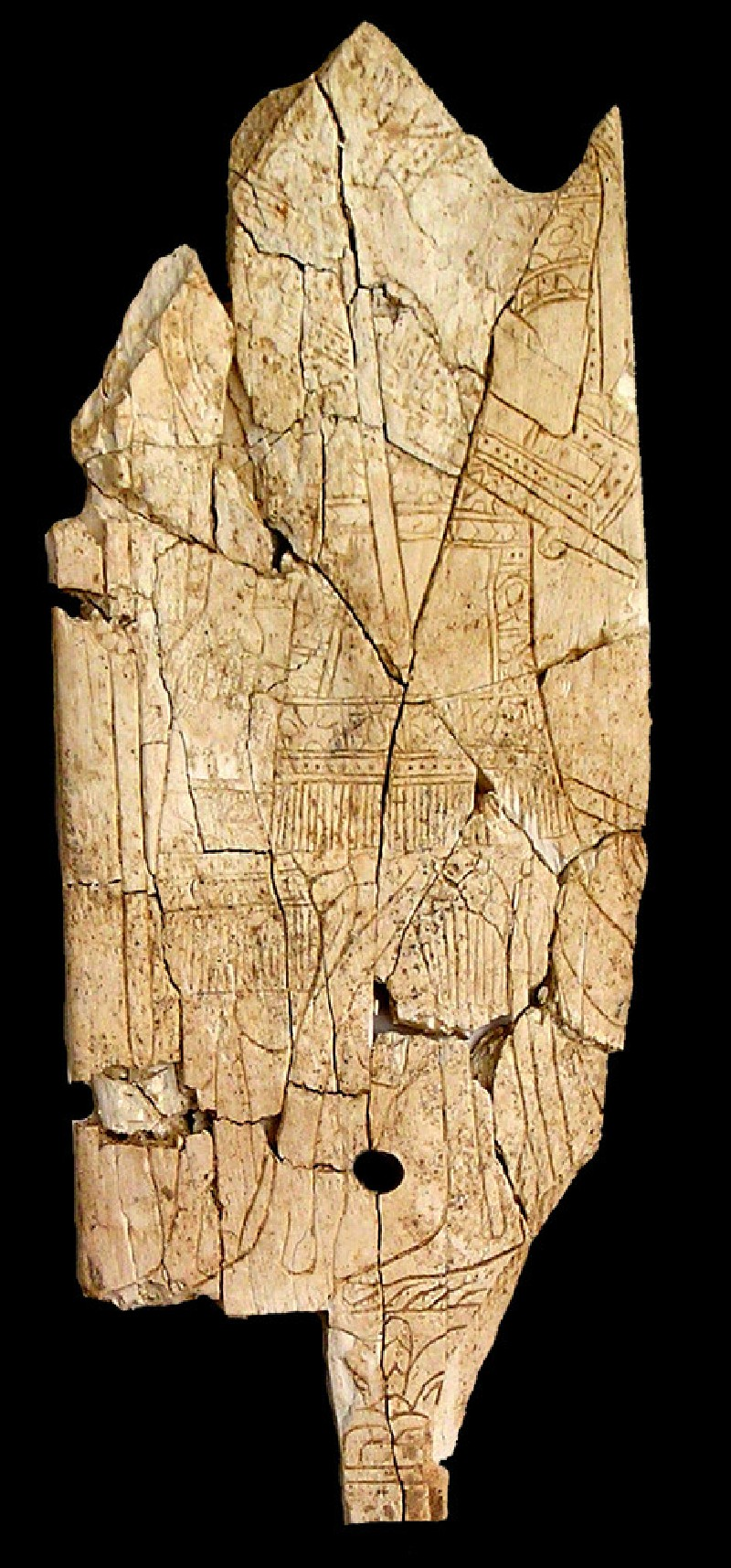 Ivory plaque depicting two Assyrians in short kilts