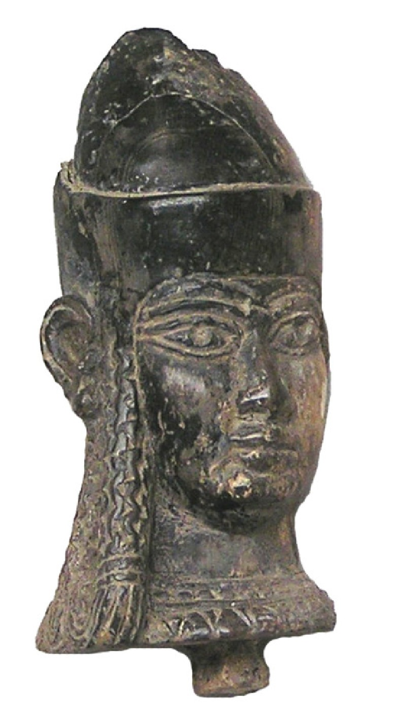 Ivory carving of figure wearing a High Egyptian crown and long tresses