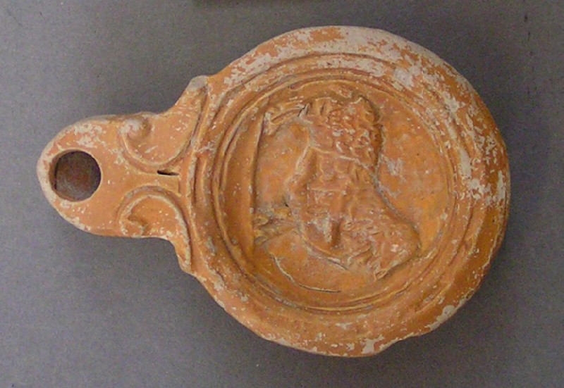 Oil lamp depicting Ulysses lashed to the belly of a ram (AN1956.933, AN.1956.933, record shot)