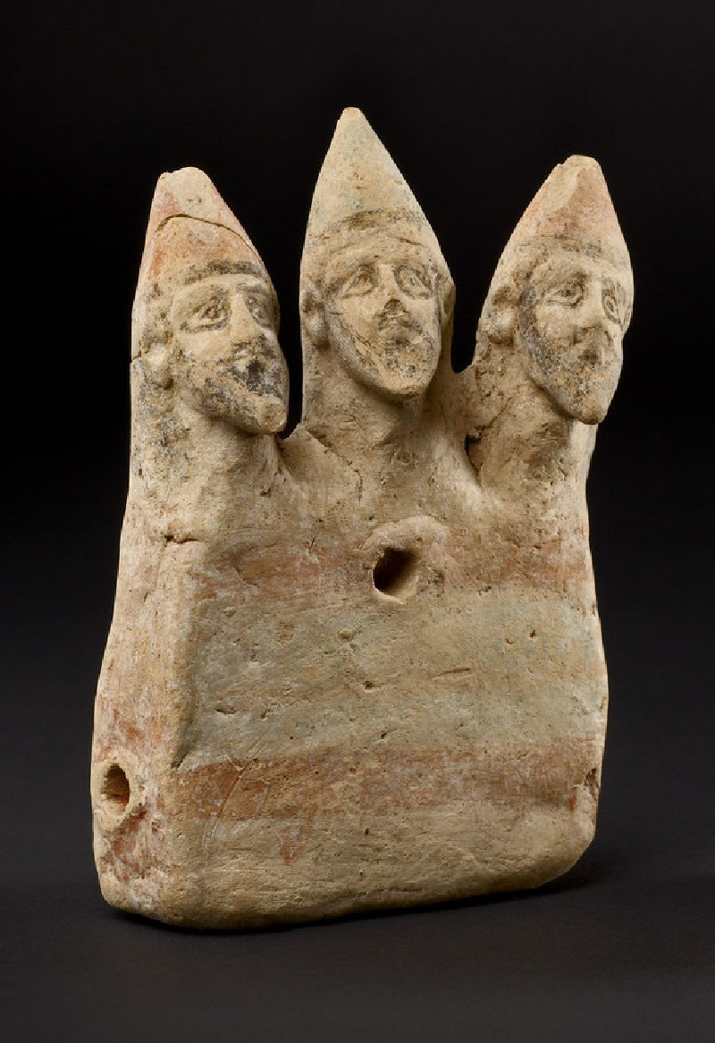 Toy figurine showing three warriors on chariot in abstract shape
