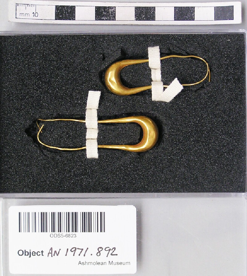 Pair of elongated hoop and boat shaped gold earrings