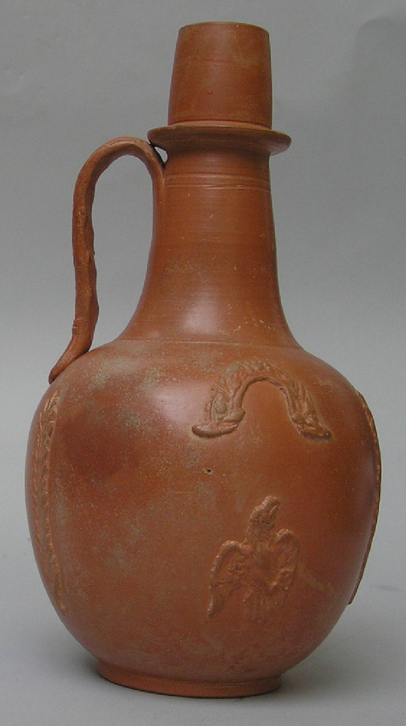 African red slip ware flagon with applied decoration of man, bird, palms and garlands (AN.1984.879)