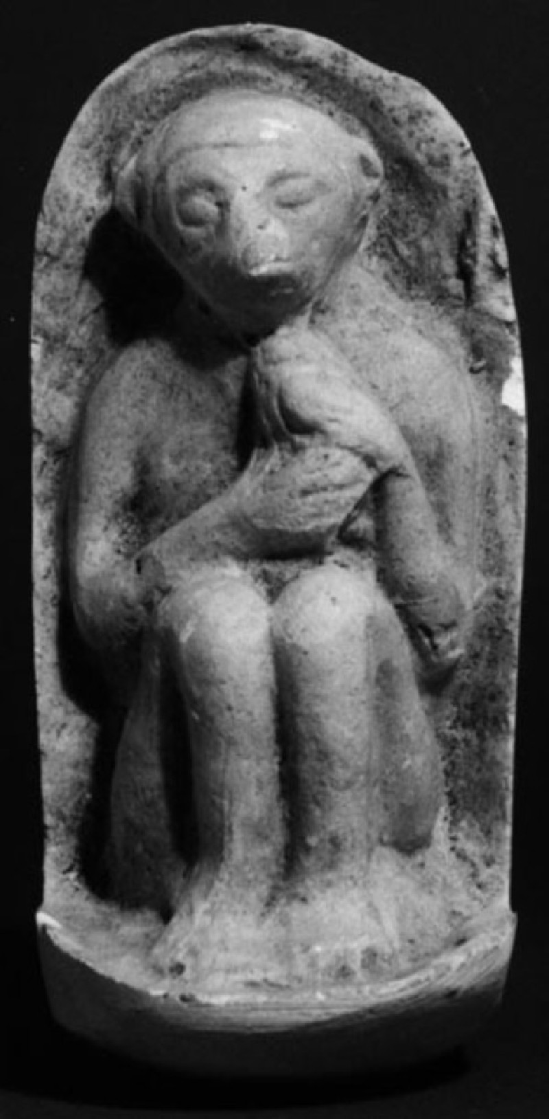 Cast of a relief of a seated monkey, possibly holding a bird, from Agrigento