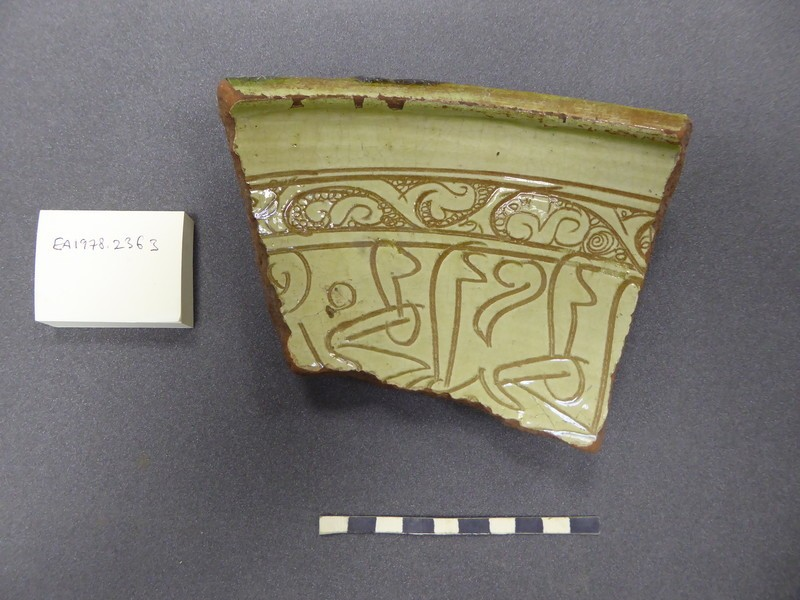 Rim fragment of a vessel with inscription