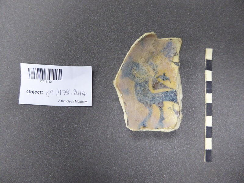 Base fragment of a bowl with quadruped