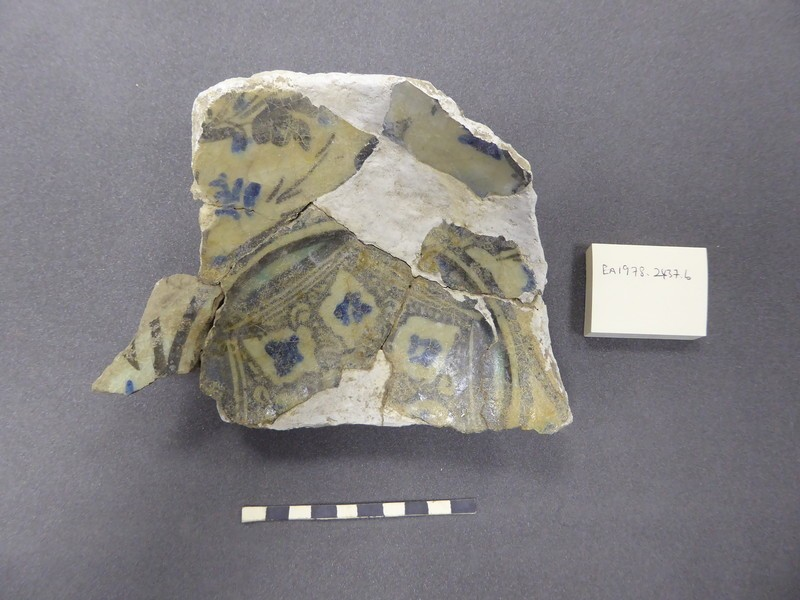 Fragmentary base of a bowl with geometric and vegetal motifs