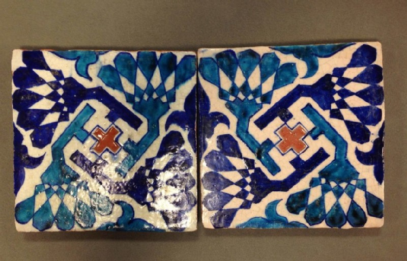Square tile with central cross and four rotating flower forms