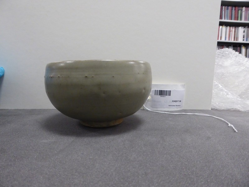 Greenware bowl with bowstring lines beneath the rim