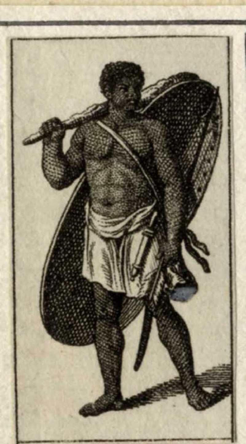 A black man carrying a large gong