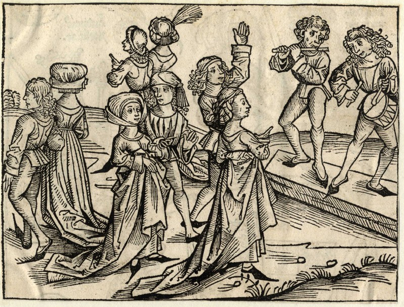 Couples dancing and two musicians