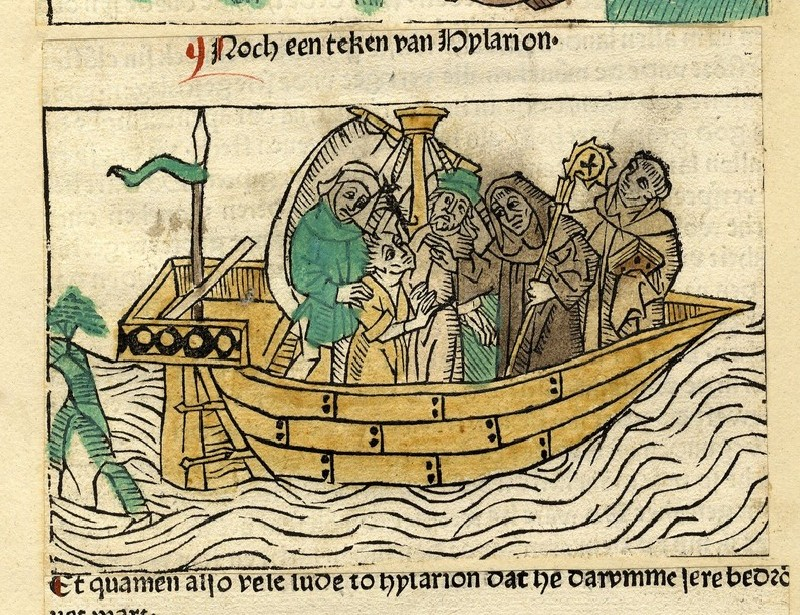 A group of five men on a boat