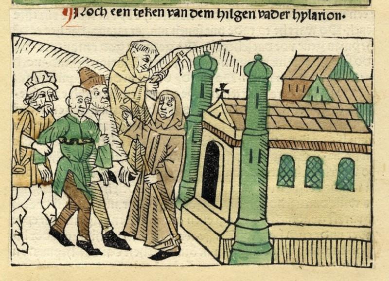 A monk blessing a man
