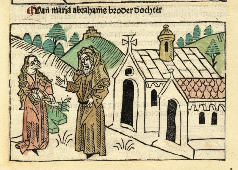 A woman and clergyman in front of a church