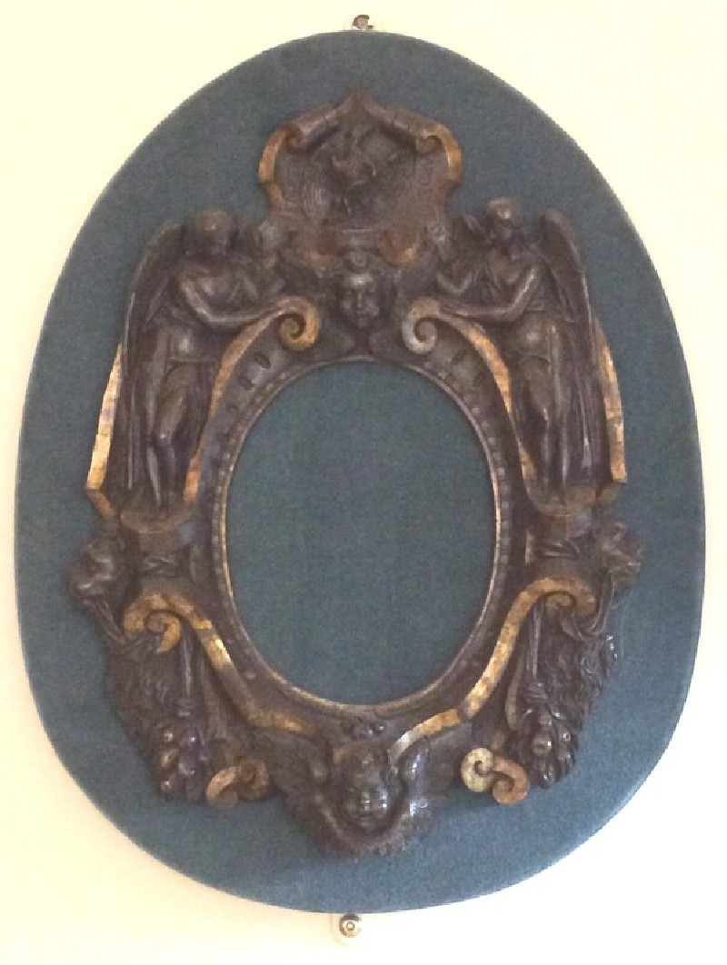 Oval frame of strapwork involving cherubin and angels