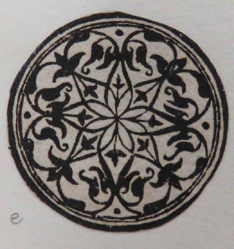 Small circular medallion with an arabesque crewelwork design in black with two concentric circles at border, from Douce Ornament Prints Album I (WA1915.84.42.5, WA1915.84.42e, record shot)