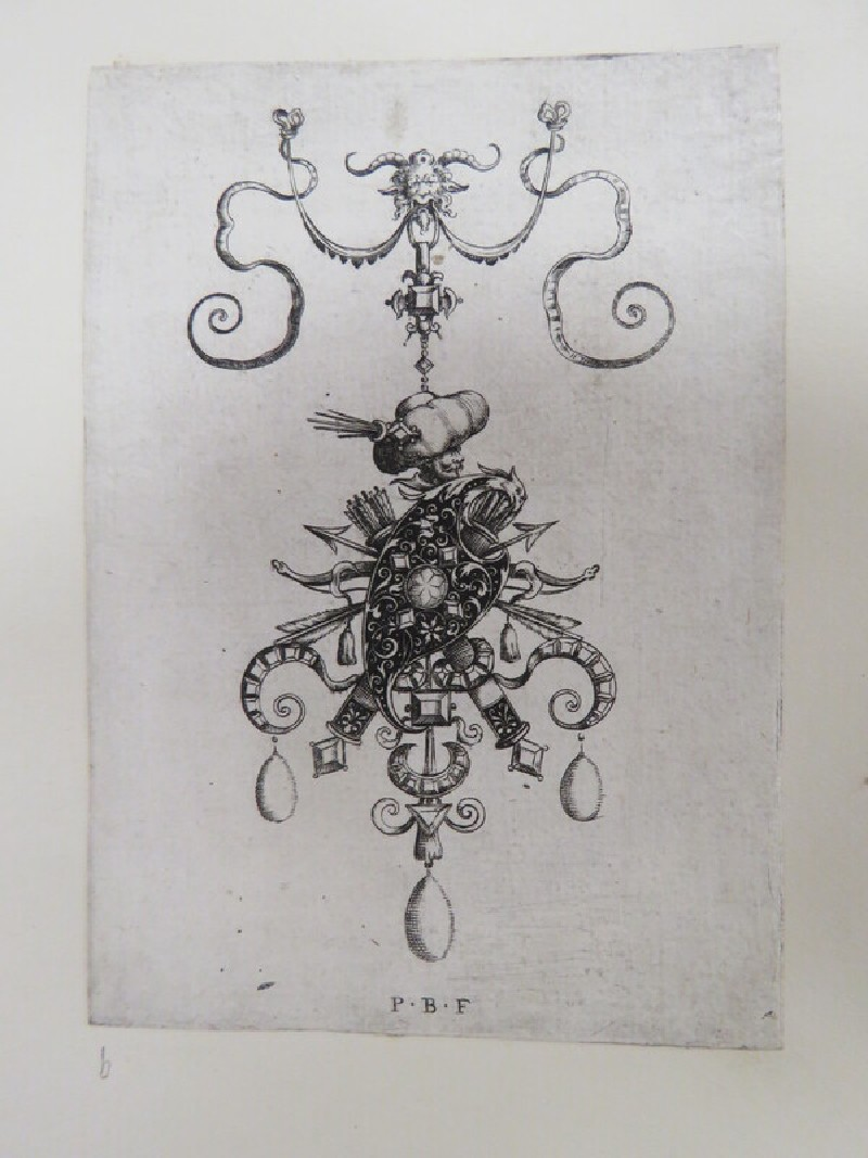 Pendant design with shield in centre surrounded by crossed arrows, quivers, and bows with head of a man wearing a turban pierced by arrows above, from Douce Ornament Prints Album I (WA1915.84.5.2, WA1915.84.5b, record shot)