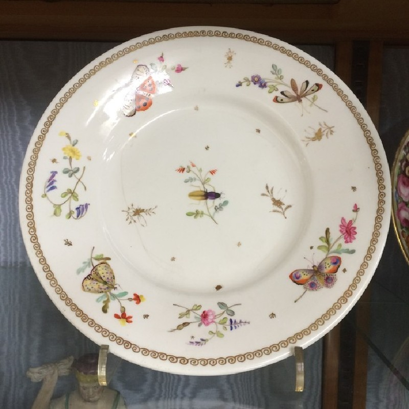 Plate, one of a pair