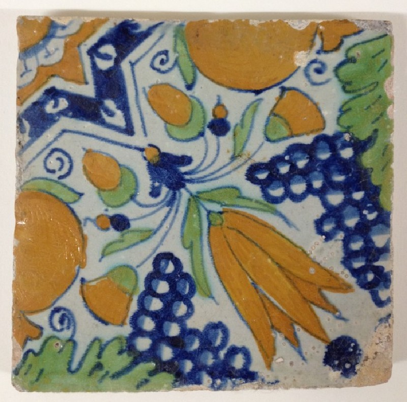 Tile with diagonal yellow tulip, pomegranates, and grapes