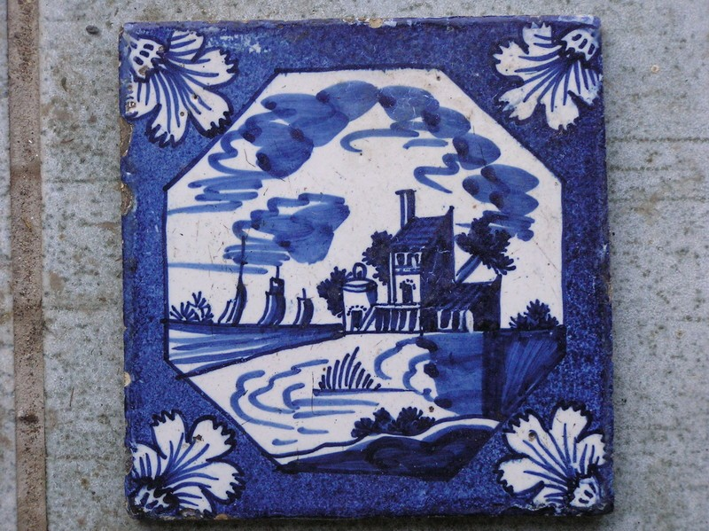 Tile with buildings and boats on estuary