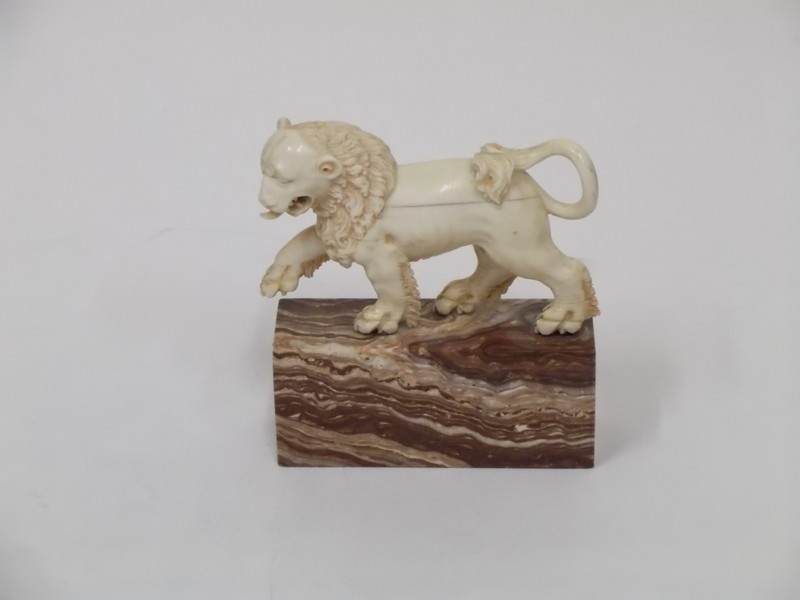 Figure of a lion walking